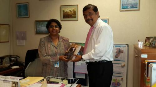 "Our CEO presenting Chairman P C Reddy's Biography "" HEALER"" to Dr. Elise Monerasinghe - Deputy Director of Oral Health Division of Malayasian Ministry during his visit to the Ministry in Malaysia."